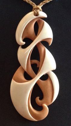 Whanau koru bone carving. Kerry Thompson.