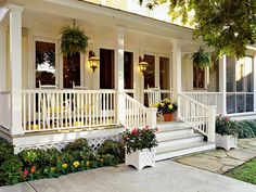 Classic White Porch - 80 Breezy Porches and Patios - Southernliving. Hanging ferns area a classic look for any Southern porch. Container gardens and a lush border add color to this space. Porches: Creating the Space Front Porch Railings, Front Porch Design, Patio Design, Porch Designs, Porch Trim, Porch Stairs, Balcony Design, Garden Design, Farmhouse Front Porches