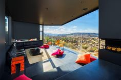 This ebony jewel in Yucca Valley, California, is the craftsmanship of design duo Oller & Pejic.  Various strategies were explored and incorporated to integrate the house into the mountainous site with a portion of the house burrowed into the ground and other portions rising off the ground to allow parking access underneath. The central design concept is the house as a shadow on the landscape, the negative of the mountain that was dynamited 40 years ago to clear the building pad.