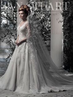 Everdina by Ian Stuart (love the veil)  This glamorous yet romantic ballgown has a feminine soft tulle overlay decorated in hand beaded lace. A matching long or short veil is also available.  Fabric: Taffeta metal & metallic beaded lace