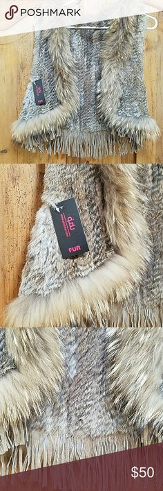 Fur Vest A really great bohemian style vest . Wear this awesome piece with anything . So soft and feathery you will fall in love . The fringe gives it that boho flaire . Quidu Jackets & Coats Vests