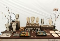 """I created some necklacedisplaysfrom fallen tree branches. They add a fun, natural touch. I also painted wooden letters to add a little """"creativity"""" to the tables."""