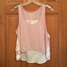 Rose crop top Flowy cute rose colored crop top. Bought it at Marshalls and never got around to wearing it. Can fit a small. Back has pictures of flowers on it. Perfect for spring and summer. Could be paired with high waisted shorts. New without tags  American Eagle Outfitters Tops Crop Tops