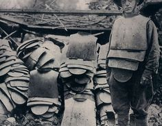 """American soldiers captured a lot of german """"Sappenpanzer"""" body armour in Argonne, France, 1918."""