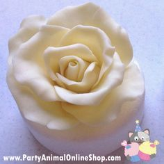 Rose tutorial using white chocolate modelling paste by PartyAnimalOnline