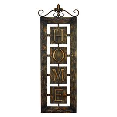 This lovely metal wall plaque is rust free and finished in a goldtone shade over a brown base. The plaque hangs vertically prominently displaying the word 'home' with several other words in script around the exterior.