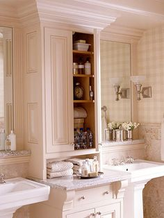 To provide storage space for bath supplies and counterspace for toiletries, include a freestanding or built-in hutch like this one