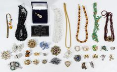 Lot 568: Rhinestone and Crystal Jewelry Assortment; Including necklaces, brooches, clip earrings, a card case and an A&S Atwood collection pin in original box