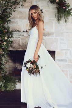 With a timeless, flattering silhouette and striking, yet understated details, our Tara gown was made for the effortlessly beautiful modern romantic.
