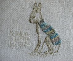 """This piece is hand embroidered on repurposed white linen fabric with cotton thread.    Size approx. 4.7"""" (12 cm) x 4.3"""" (11 cm).    The embroidery is attached to stiff interfacing and backed with white cotton.  Signed with initials."""