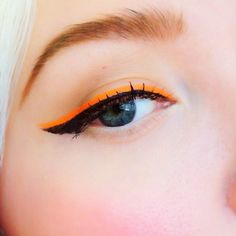A line of bright or neon color just above the eyeliner.