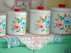 I would love these cannisters in my kitchen. And the color of the cabinets is so very perfect.