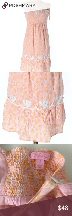 Lilly pulitzer linen dress in light pink + orange Very pretty in good but used condition Lilly dress with light pink and orange flowers. With white ribbon details and smocked elastic in the back. It's fully lined and has a zipper (see last picture) on the side. Lilly Pulitzer Dresses Midi