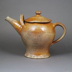 WALTER KEELER (British, b.1942) AR Teapot, circa 1980 Stoneware, brown saltglaze, incised spiral pattern to the lid, mounted crimped foot, mounted with two looping handles, impressed maker's mark