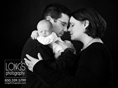 Tallahassee baby and family photographer, Linda Long of Long's Photography, captures this moment of love with newborn addition in black and white photography