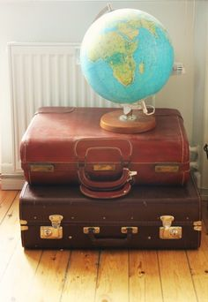 Yet another vintage suitcase stack - this time with a globe. Wanna arround the world?