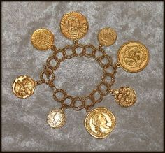 "Susan Shaw Gold Italian Intaglio ""Coin"" Bracelet •1 1/8 inch diameter 24k gold plate intaglio ""coin"" charms •7"" large 24k gold plate double link twisted rope chain with toggle clasp •Coins are 1 inch diameter •Created by Susan Shaw. Made in the USA in San Antonio, Texas. •Natural aged look LIMITED QUANTITY PLEASE CALL FOR MORE INFORMATION ON THIS PRODUCT ~ 814-763-4916 Item #: #2733CR"