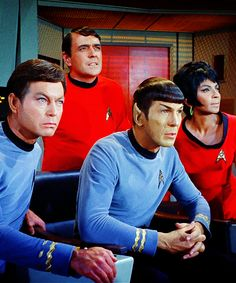 The Enterprise crew intently watching the ship's view screen as Kirk fights the gorn. From Arena (Star Trek)
