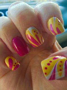 Fun nail design created in water then applied to nails. Dots added after. Fuchsia, yellow and white.