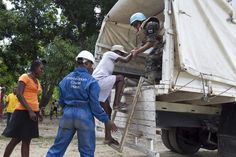 Haiti -- UN peacekeepers from Paraguay and members of the Haitian Department of Civil Protection evacuate residents during a disaster response simulation on 9 July 2012. UNDP is working with the UN Mission and the Government to prepare Haiti for its next natural disaster. www.undp.org