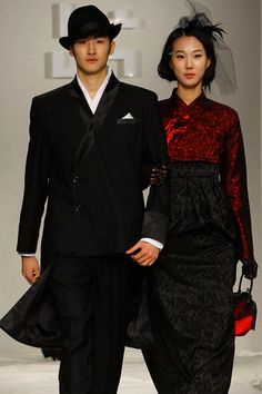 From a 2011 fashion show in Korea, where traditional Korean dress is combined with Western styles.