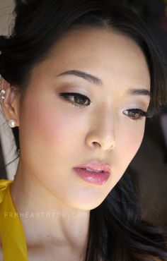 More western style makeup defined eye crease, fluttery lashes, pink lips and cheeks