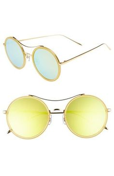 Iridescent lenses and round frames brings retro glamour to these pastel blue sunglasses.
