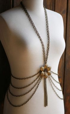 Brass body chain with flower. I have no idea what I would wear it with but...wow.