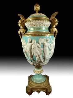"SEVRES FRENCH 19TH CENTURY BAS RELIEF PORCELAIN & BRONZE DORE URN. APPROX 15.75"" H"