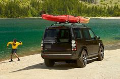 The Discovery HSE in Santorini Black with canoe roof rack Range Rover Discovery, 4x4, Land Rover Models, Mid Size Suv, Off Road Adventure, Luxury Suv, Offroad, Kayaking, Cool Cars