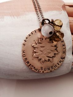"""This is my signature design.  I am sure plenty of you guys out there know a women like this ;) A large brass Disc Hand stamped to read """" Sunshine mixed with a little hurricane"""" surrounds a brass sun t"""
