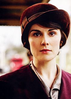Lady Mary always looks wonderful in the rich red-purples they dress her in (Downton Abbey)