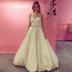 We're in love with this modern princess look featuring a balloon hem! Ball gown by Birnbaum & Bullock.
