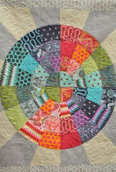 Dresden inspired quilt, fabric by Tula Pink, quilted by Angela Walters.  2013 Houston quilt market photo at Hawthorne Threads blog.