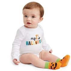 """My First Halloween - Preserve Jar Crawler & Sock Set - 2-piece set. Size 0-6 months. Makes a great gift. Glass preserve jar holds embroidered 100% cotton crawler with """"my 1st HALLOWEEN"""" graphics. Coordinating pumpkin socks are attached with clothespin. From Mud Pie."""