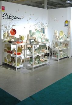 They sure accomplished a lot with a mere three light shelf units. Good color blocking makes teh booth pop. Craft Show Booths, Craft Booth Displays, Store Window Displays, Craft Show Ideas, Display Ideas, Window Display Design, Booth Design, Make Your Own Pottery, Local Craft Fairs