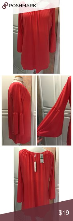 """Beautiful shirt with bell sleeves NWT The shirt can be worn dressed up or down and the fabric is a slinky, easy wear that moves and hangs easily. Polyester/spandex blend.  The 3/4 sleeves have wonderful """"bells"""".  NWT Sorry no trades. Spense Tops"""