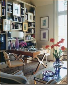 love art hung on bookshelves; love a writing desk positioned like this with chairs on either side; actually i love most anything by jan showers!