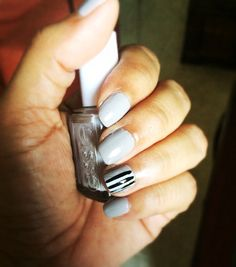 Essie take it outside with some white colorblocking and black stripes nail mani