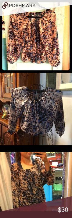 🆕Chic leopard bo-ho top!🐆 NWT Adorable leopard top with hues of blue in the colors. I just bought this and it's to snug on me. Such a great top! Pair with skinnies, boots and a floppy hat, and your definitely going to stand out! Flowy chenel fabric. Oh so chic and on trend!🚫NO OFFLINE TRANSACTIONS✔️BUNDLE AND SAVE❗️ Olivaceous Tops Blouses