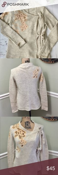 Anthropologie- Moth Sweater Anthropologie-Moth Sweater worn once, excellent condition. Adorable cream with lace and side tie- pair with your favorite denim and boots to complete the look. Excellent quality- don't you just love Anthropologie?!? Anthropologie Sweaters