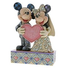 Commemorate your special day with our beautiful Mickey and Minnie Wedding Figurine! The hand-painted design combines Jim Shore's folk-inspired style with a classic Disney romance, to create an exquisitely crafted piece. Mickey Mouse Figurines, Minnie Mouse, Disney Figurines, Disney Romance, Mickey And Minnie Wedding, Simba And Nala, Boy Best Friend, Honeymoon Fund, Disney Traditions