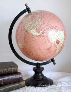 A pretty pink and gold world map globe