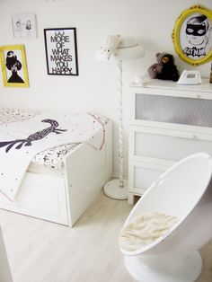 Loving... small amounts of yellow making a white and black room pop...