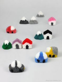 Pom Pom Play Village: Soft yarn in bright hues is all you need to create a playful pom pom village for your mantel.