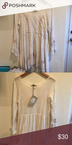 NWT White Embroidered Peasant Dress World Market Brand new! Perfect for a beach cover up. From world market but looks exactly like free people! Free People Dresses Mini
