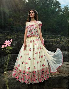 This off white lehenga choli is crafted by floral embroidery. We have tried to give it the beauty of fantasy land. This lehenga choli is made of high quality soft net enhanced with thread and sequins embroidery. Floral Lehenga, Net Lehenga, Lehenga Choli Online, Bridal Lehenga Choli, Simple Lehenga, Net Blouses, Party Wear Lehenga, Off White Color, Beige Color