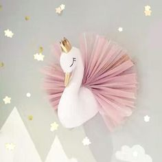 Beautiful swan room decor. Perfect for any little girl that loves princesses or tutus! Features a tiny gold crown and sweet pink tutu! This swan hangs on the wall and measures 40x40cm. Please allow 2-4 weeks for delivery. FREE SHIPPING!