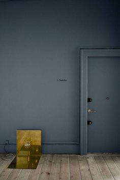 The entryway to Christophersen's apartment is painted in St. Paul's Blue, a gorgeous and moodly slate gray-meets-blue shade he developed for Danish paint company Jotun, which looks gorgeous paired with bold and modern brass accents. More from the Frama Shop in Copenhagen on Remodelista.