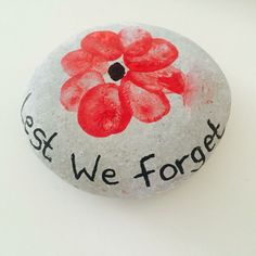 My son created a beautiful poppy memorial at school and when we came home we decided to create a memorial Stone - Our first try at rock painting. We usually collect small pebbles from beaches we visit and create magnets from them and use it to 'pin' a pho Remembrance Day Poems, Remembrance Day Activities, Remembrance Poppy, Poppy Craft For Kids, Art For Kids, Crafts For Kids, Rock Crafts, Fall Crafts, Stone Crafts